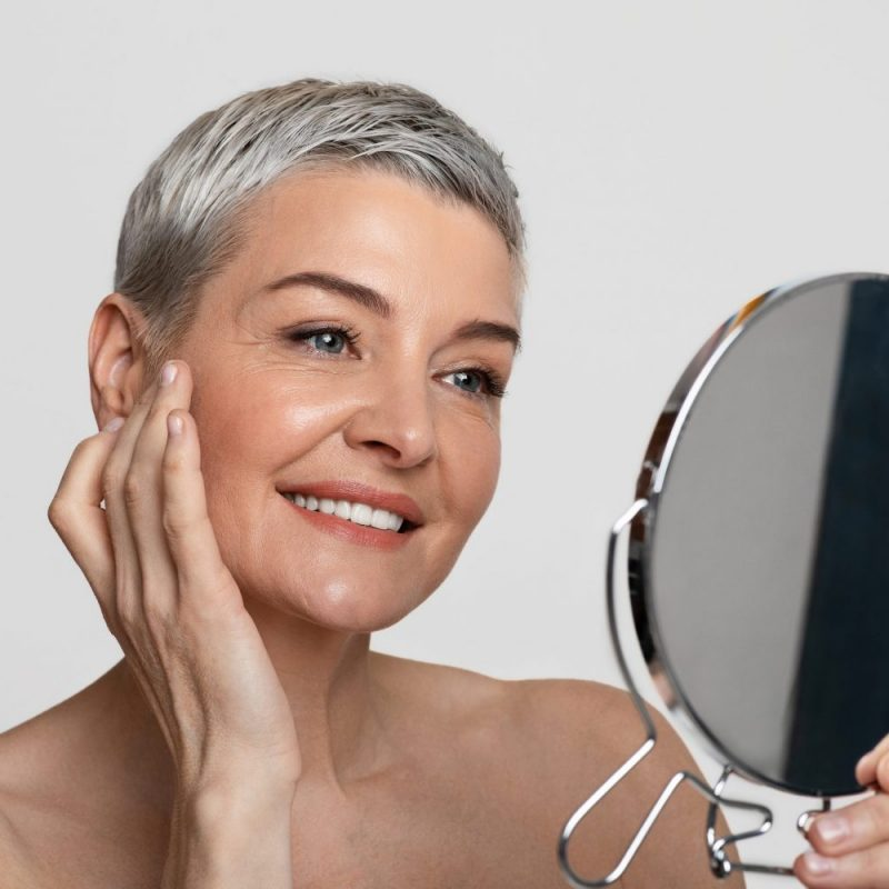 Skincare For Middle-aged Women. Beautiful Mature Lady Looking At